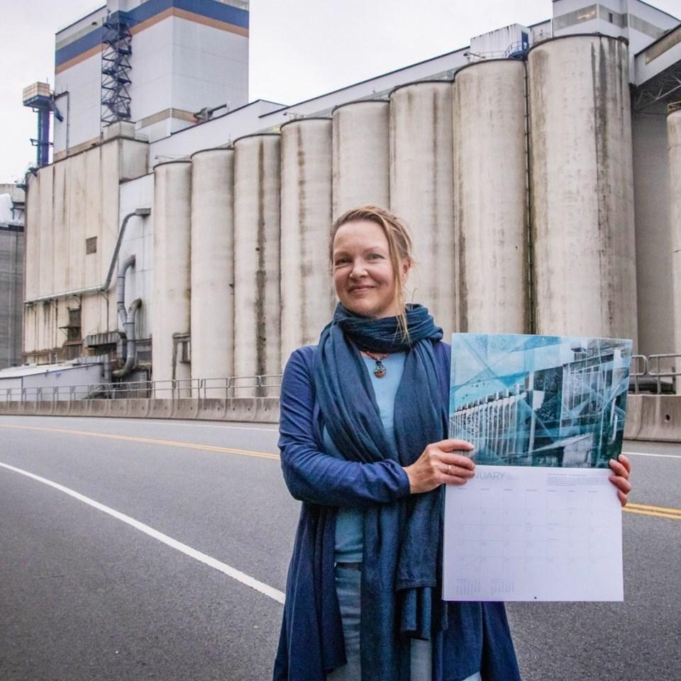 Kathleen Ainscough holding her artwork