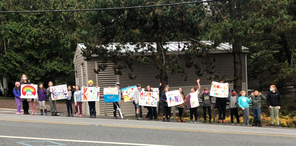 BICS students holding a 'kindness parade on Trunk Rd.