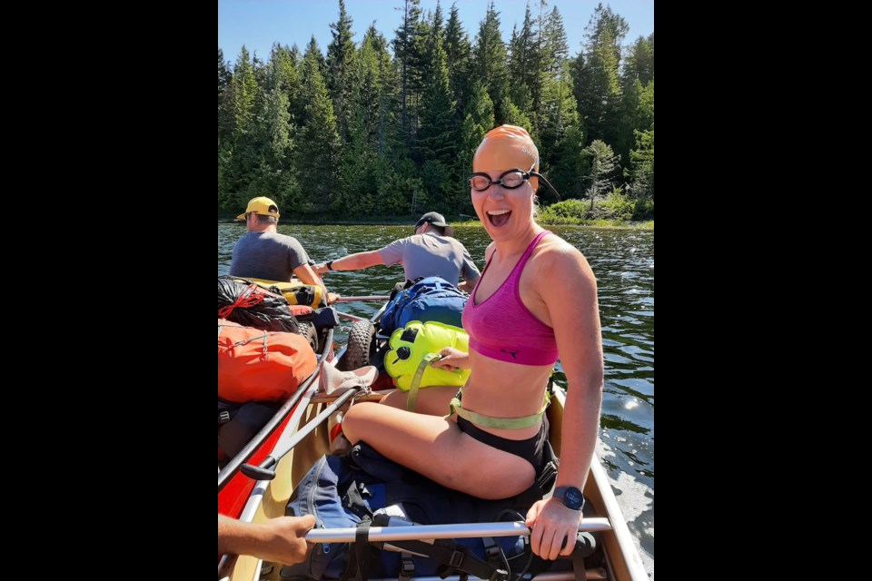 Anna fits in her swim distance during her canoe portaging trip last week. She, along with SwimBowen friends, are swimming a total 32 km to raise awareness and funds for SwimBowen.