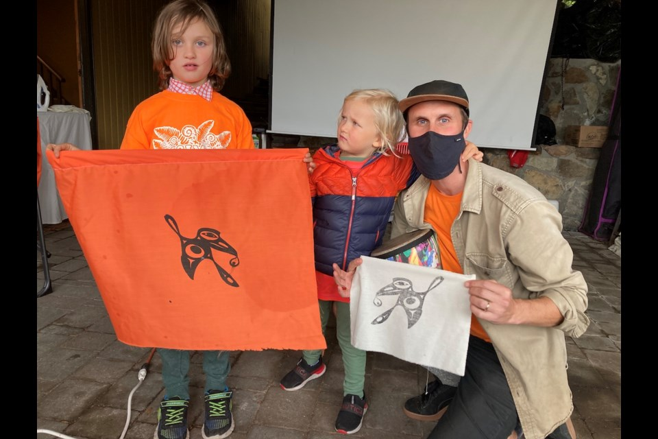 Franklin, Louie and Zac hold up their hummingbird flags.