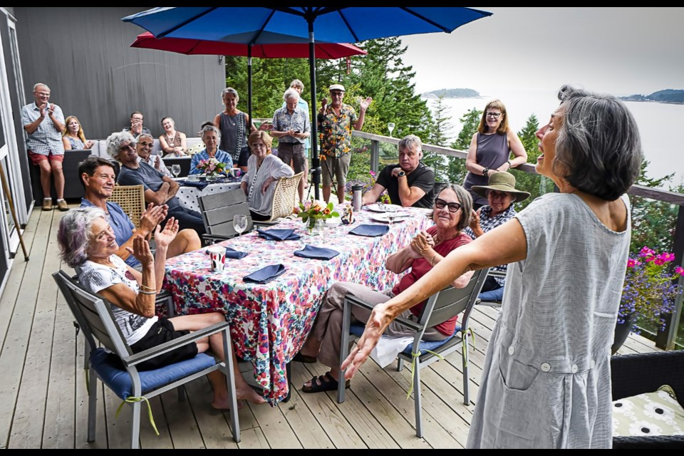 Rosemary addresses the crowd of friends gathered at a waffle party in late July 2021 to celebrate her geophysics award.