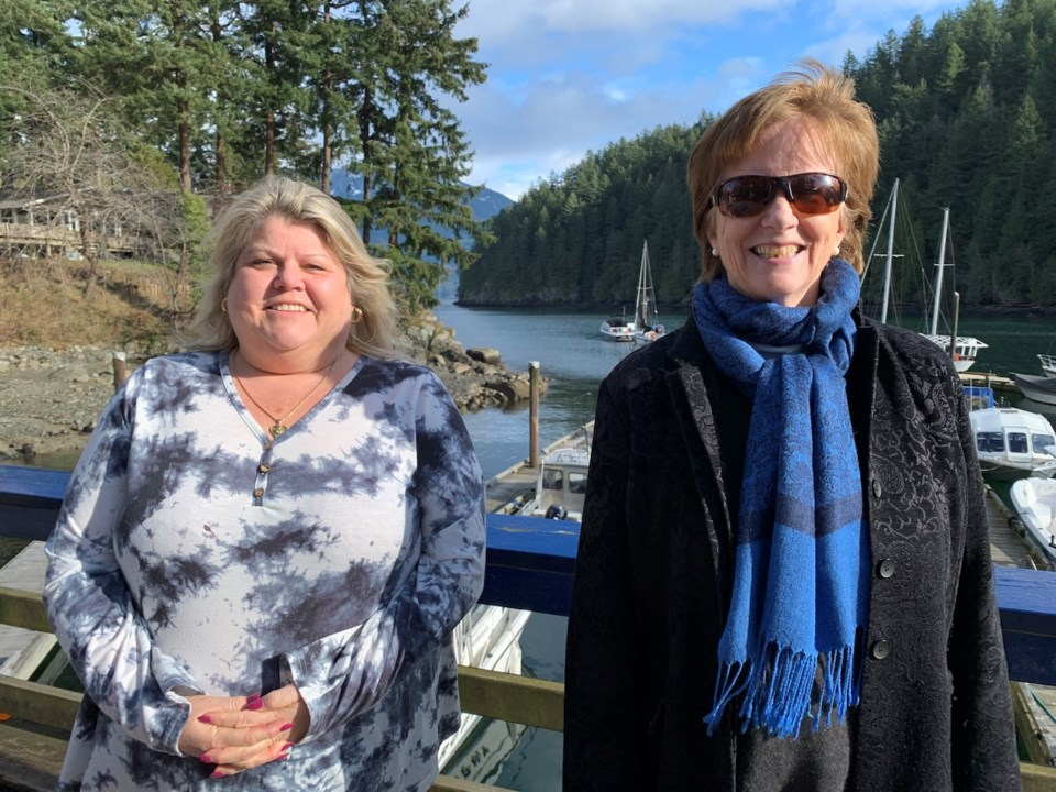 Kim Sinclair standing with Colleen O'Neil on the Bowen government dock