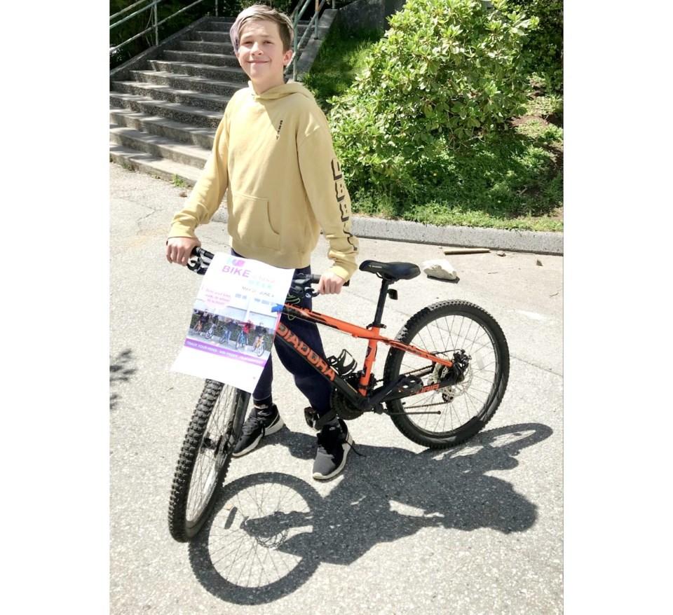 Trey with a bike