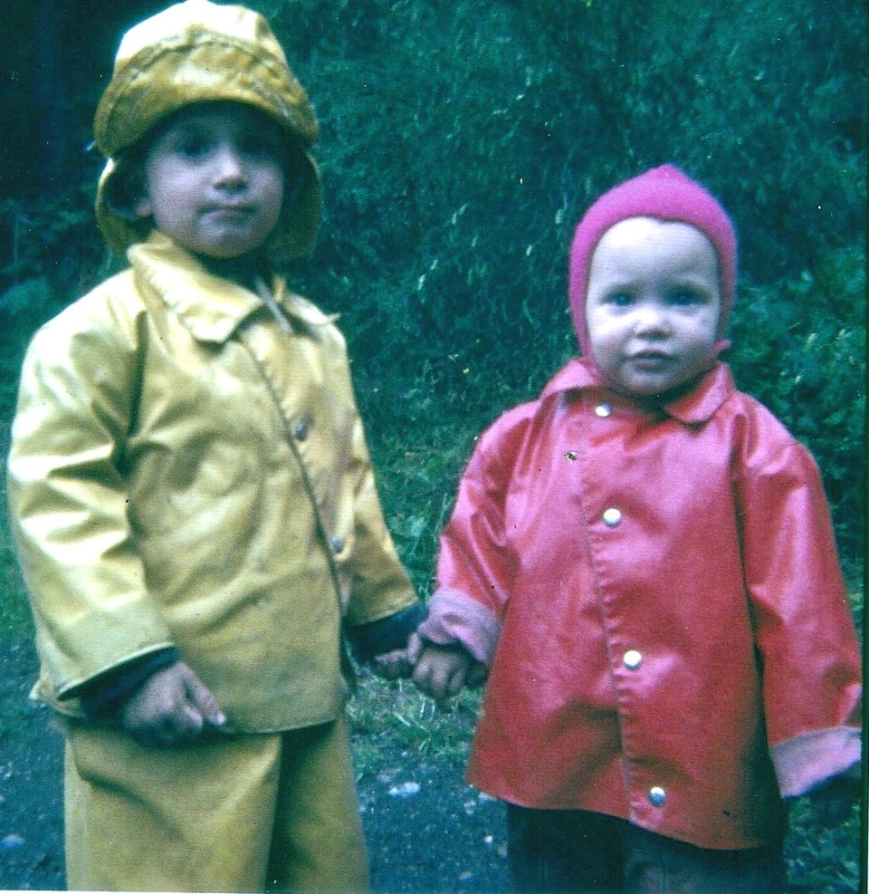 John and Mary Letson in rain gear as young children