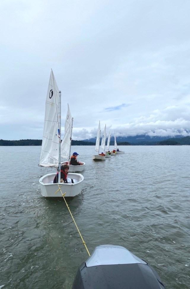 BIYC sailboats being towed
