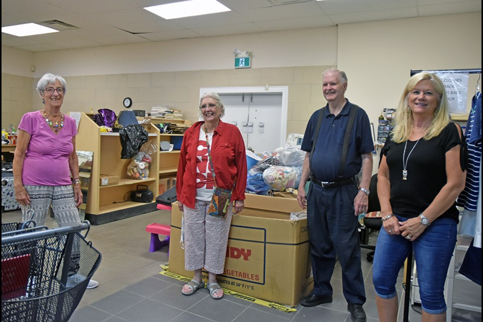 From left, Matthy Dupin, Marjorie and Ron Carnegie, and Marg Kooy work behind the scenes at ReSource Thrift Shop. Miriam King/Bradford Today