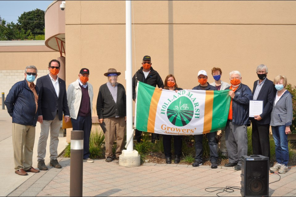 Celebrating the 95th anniversary of the Holland Marsh Drainage (flag raising): Members of BWG town council, Jody Mott from the Holland Marsh Growers Association, BWG Mayor Rob Keffer, and Art Janse (drainage commissioner and consultant on the Holland Marsh) and supporters. Jackie Kozak/BradfordToday