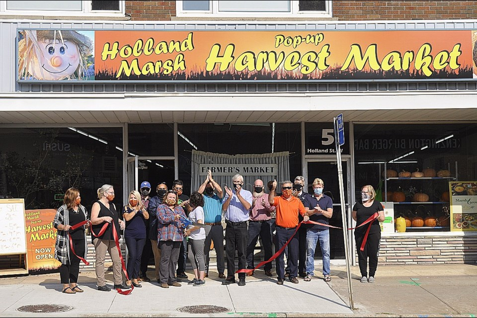 It was a beautiful day for the ribbon cutting at the official grand opening of the new pop-up Harvest Market on Saturday morning. Jackie Kozak/BradfordToday.