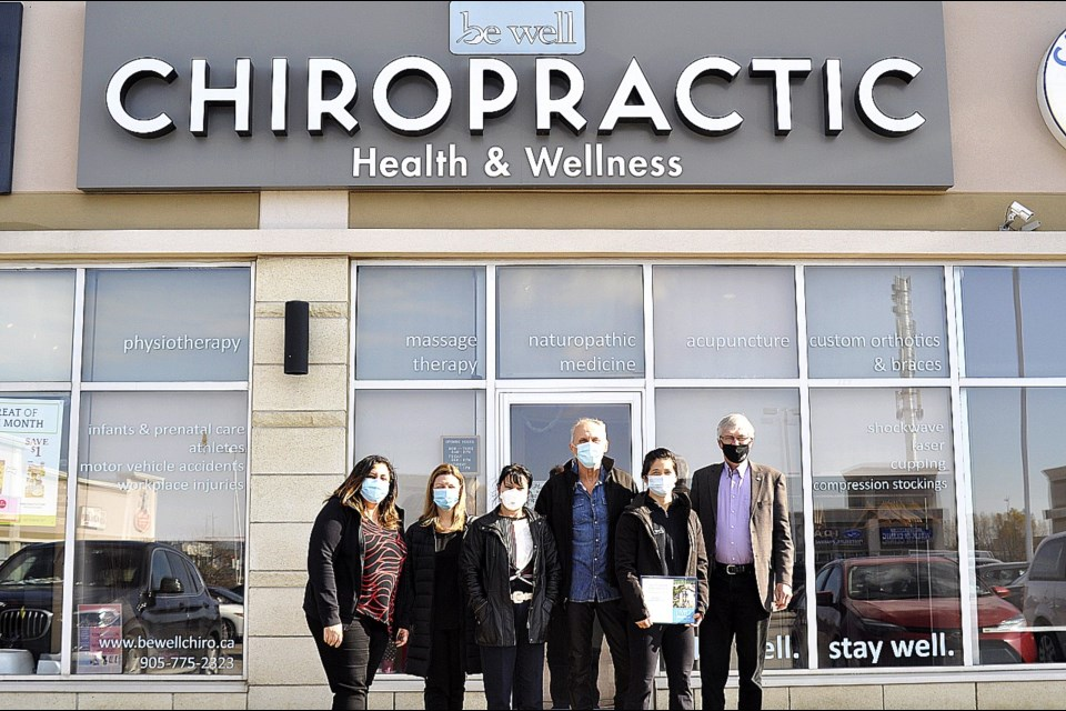 Staff and practitioners at the Be Well Chiropractic Health & Wellness Centre celebrated their 10th year in business, joined by Owner Dr. Leeann Ng and Major Rob Keffer. JackieKozak/BradfordToday
