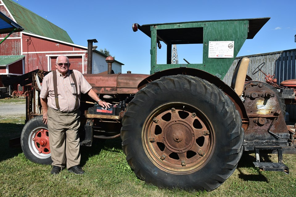 Bill Vernon with his 1945 McCormick Deering WD9 , which will be on the auction block. Miriam King/Bradford Today