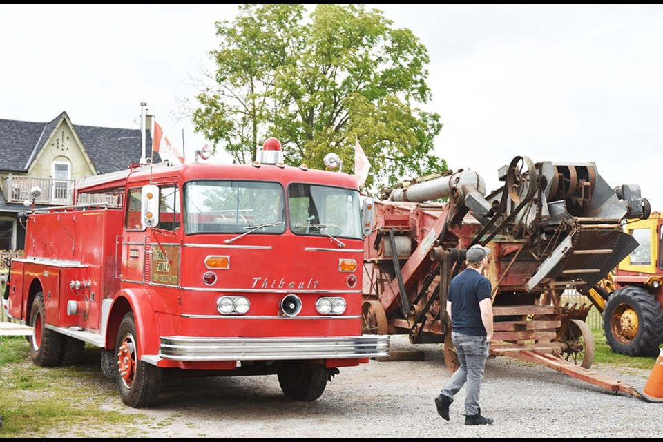 Checking out the fire truck and threshing machine, both part of Bill Vernon's collection up for auction Saturday. Miriam King/Bradford Today