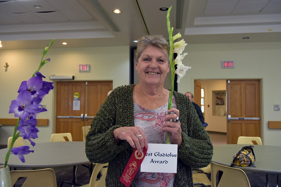 Cathy Reid with her perfectly proportioned Gladiolus, winner of the Gladiolus Award at the Innisfil Garden Club. Miriam King/Bradford Today