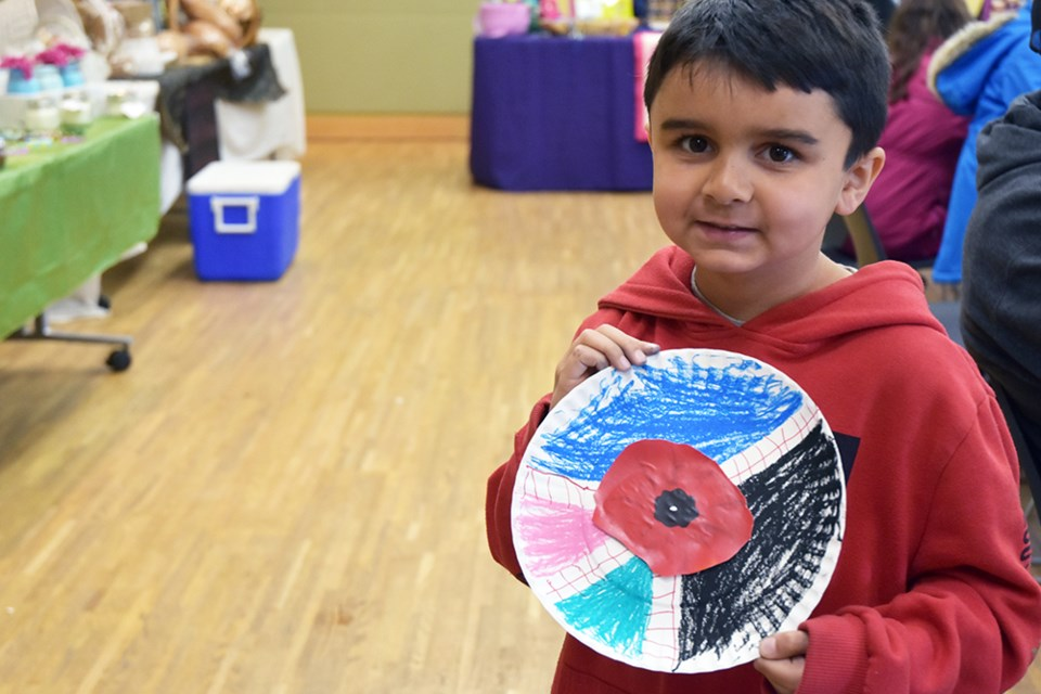 Kids made poppy crafts for Remembrance at the Bradford Farmers' Market on Saturday. Miriam King/Bradford Today