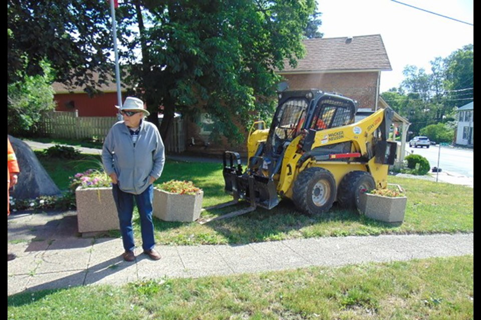 A Bond Head-Bradford Garden Club member surveys the Audrey Wychopen Memorial Parkette in Bond Head. SUBMITTED