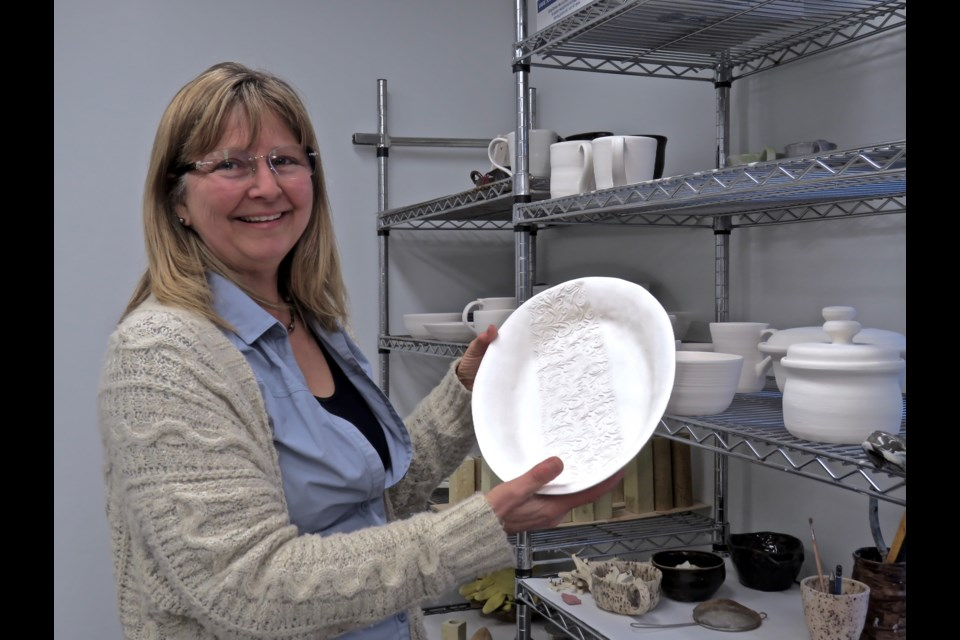Andrea Nolan-Parry shows some bisque ware at her Newton Robinson personal studio. She's very excited about now being able to make pots with lids as she continues to expand her capabilities.  A pattern was rolled onto the raw clay platter before the first firing. All the pieces will receive a glaze and fired again to produce the final product. Rosaleen Egan for Bradford Today