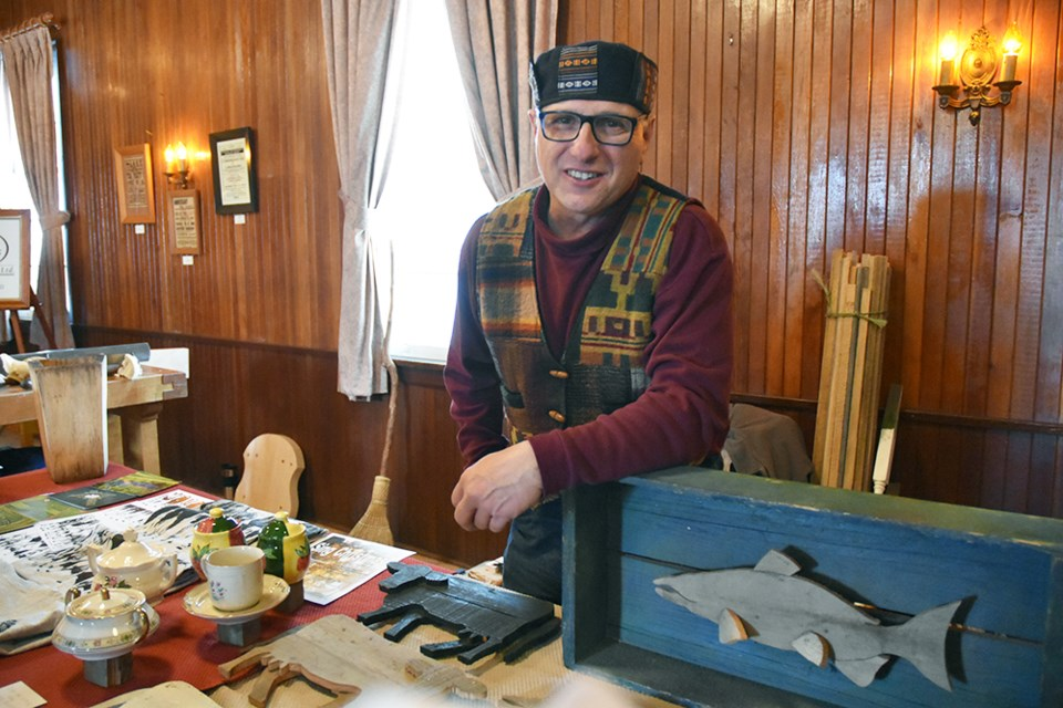 Denis Bolohan with early works, and postcards of his large-scale labyrinths, at the Artisans' Fair in Newton Robinson, Nov. 16. Miriam King/Bradford Today