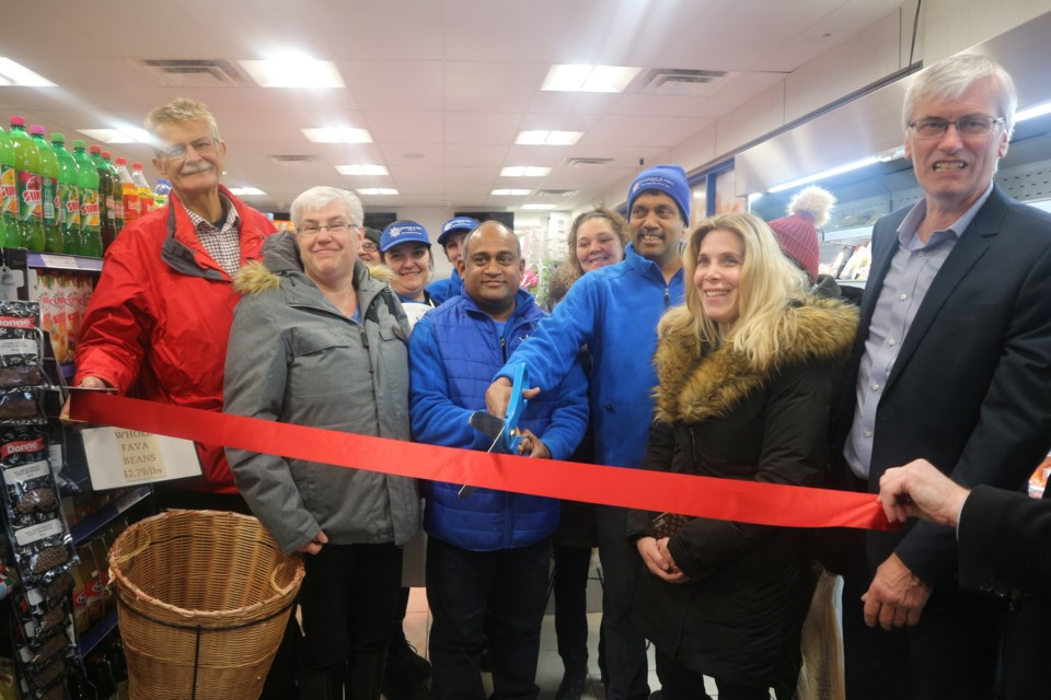 7C Seafood owners and staff, along with their staff, Mayor Rob Keffer and members of council and Bradford Board of Trade at Friday's grand re-opening celebration. Natasha Philpott/BradfordToday