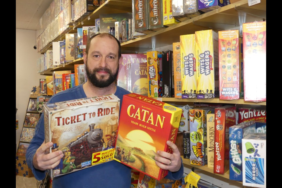 Brian Hayden, co-owner of Experience Toys and Games in downtown Bradford, is starting a board games night. Jenni Dunning/BradfordToday