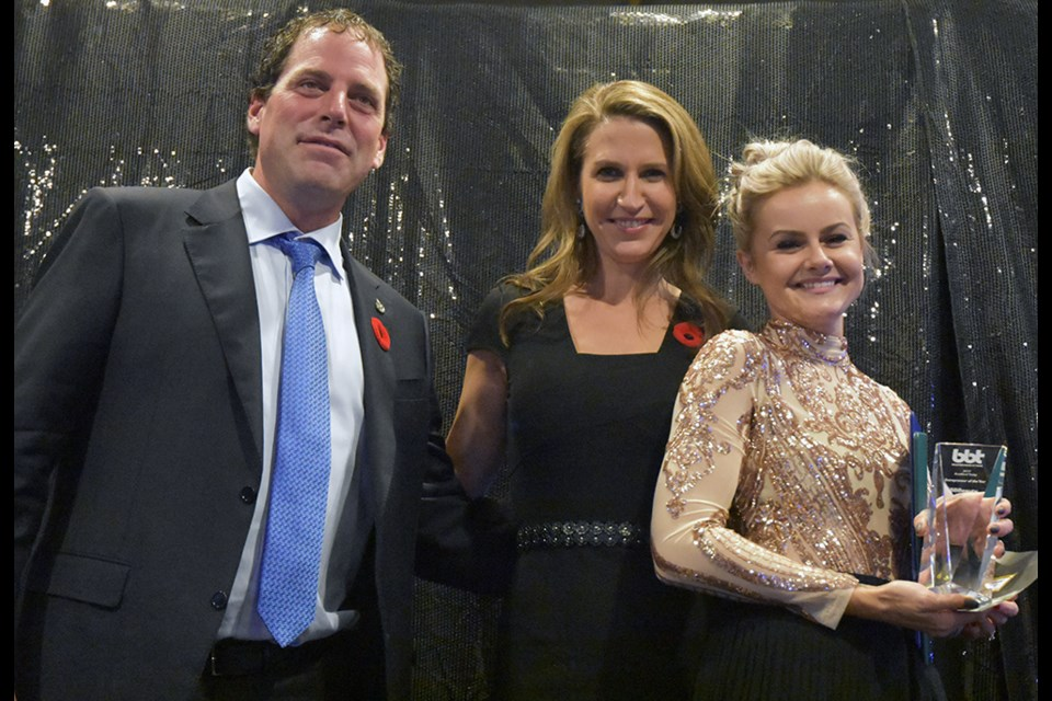 MP Scot Davidson and Minister of Transportation, MPP Caroline Mulroney present the award for Entrepreneur of the Year award to Brittany Buck of Brittany Buck Beauty Boutique. Miriam King/Bradford Today