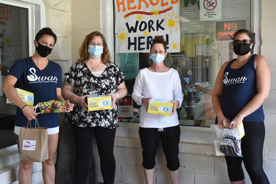 From right, S.W.A.N. Bradford president Natasha Leskiw presents donation of face masks to The Loft's program director Carolyn Donaldson and Tami Madigan, assisted by S.W.A.N. Jackie Kozak. Miriam King/Bradford Today