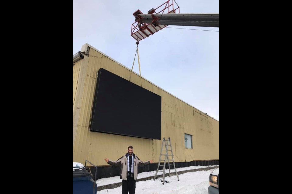Mark Snaper and the new 10x15 digital screen that's been installed at the side of 121 Bridge Street. Submitted Photo