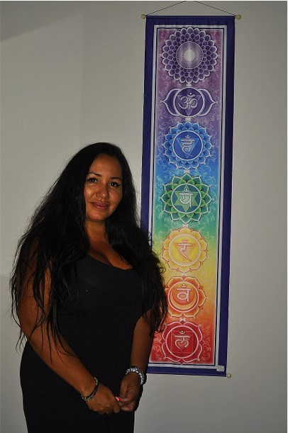 Reiki Practitioner Andrea Silva focuses on clearing blockages and balancing energies while using the seven chakra model practiced by Reiki masters. Jackie Kozak/BradfordToday