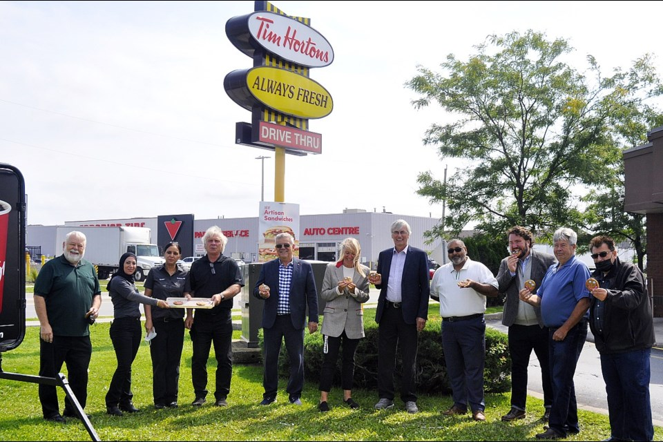 2021 Smile Cookie campaign at Bradford Tim Hortons (left-right): Coun. Gary Lamb, Tim Hortons staff with Owner Perry Thornton, Deputy Mayor James Leduc, Christina Bisanz (CEO-CHATS), Mayor Rob Keffer, Coun. Raj Sandhu, Coun. Jonathan Scott, Coun. Ron Orr, and Coun. Peter Dykie