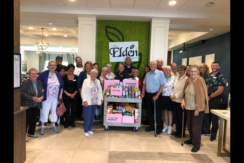 The residents and staff of The Elden were happy to present their collection of non perishable food items to the Helping Hand Food Bank on Thursday morning. Natasha Philpott/BradfordToday
