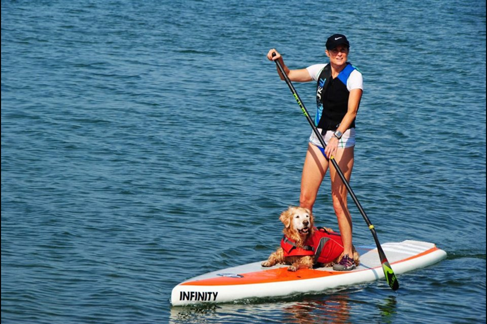 Buddy Paddles Simcoe, raising funds for COPE Service Dogs, July 27. Kim Jeffery/SUBMITTED.