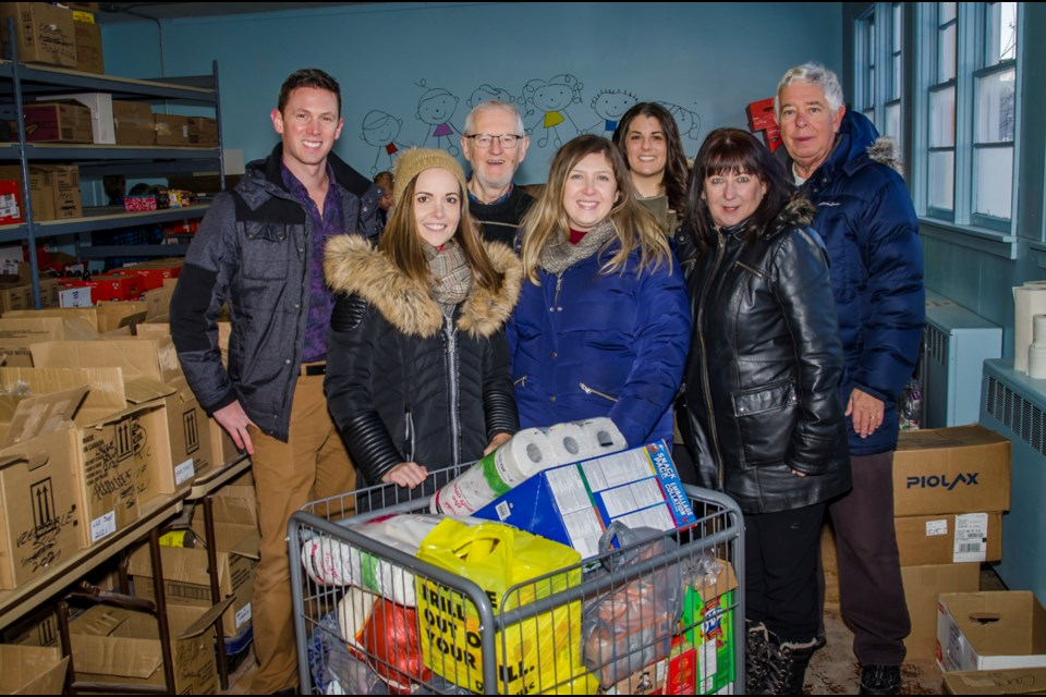 Eric Andrews and the team at The Co-operators Bradford have been collecting donations to the Helping Hand Food Bank  for the last month. Today they made the delivery, just in time for Christmas. From left to right: Eric Andrews, Vanessa Johnson, Oliver Pajunen, Christina Ciotoli, Katelyn Espie, Catherine Douglas and Alvin Belanger. Dave Kramer for BradfordToday.