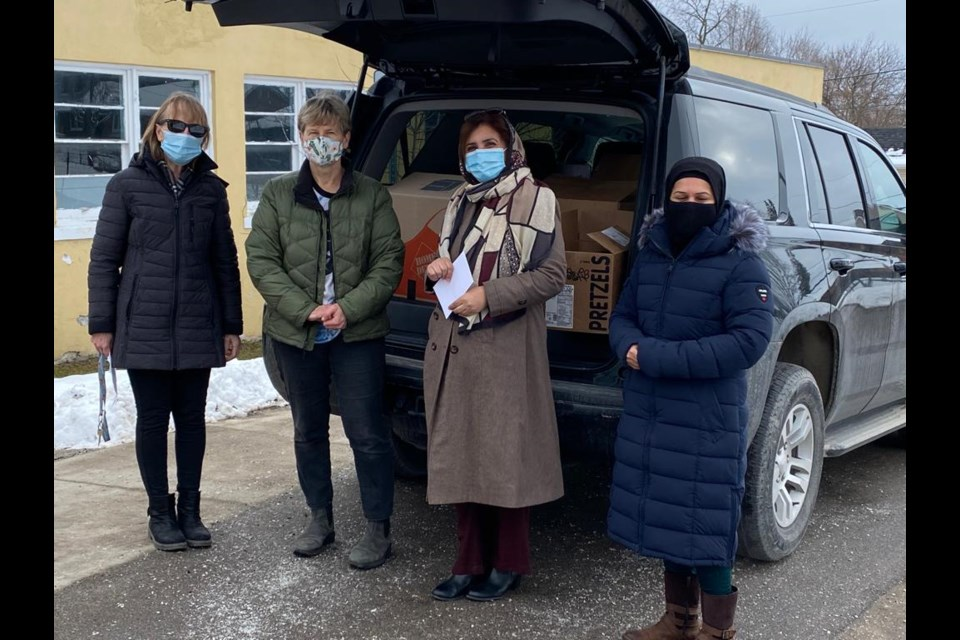 Ahmadiyya Muslim Women's Association donated 1400 pounds of food the Helping Hand Food Bank this month.