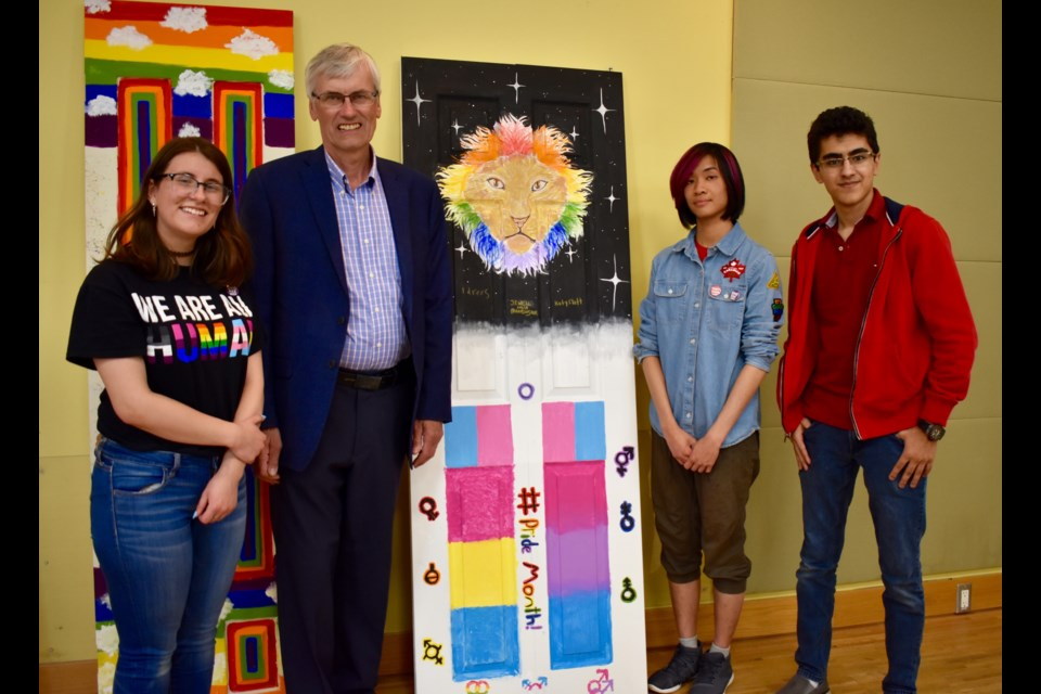 BWG Mayor Rob Keffer, second from left, with the artists of the door with the lion, Katy Flatt, Jewell Hua, and Idrees. Melanie Pileggi for BradfordToday