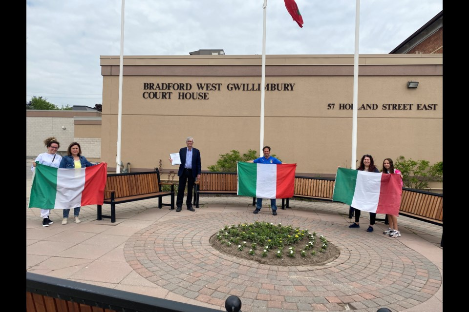 Mayor Rob Keffer and Coun. Peter Ferragine along with members of the Bradford Italian Association stand outside the courthouse Tuesday afternoon for a flag raising and proclamation reading for Festa della Repubblica. Natasha Phipott/BradfordToday