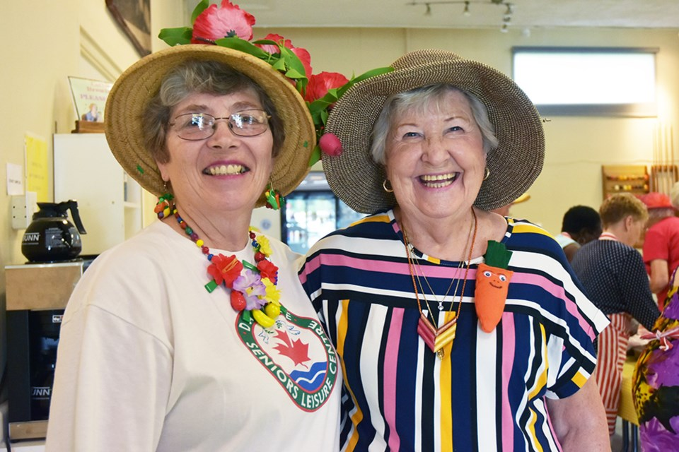 Jan Evans, left, and past president Elaine Love wear summer hats to the Salad Days Luncheon at the Danube Centre. Miriam King/Bradford Today