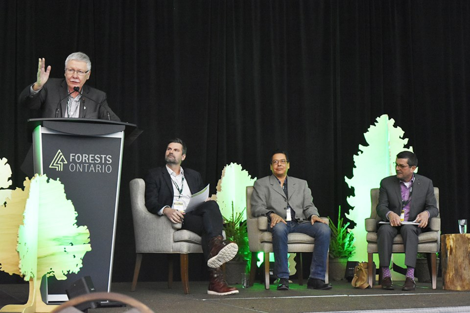 Steve Hounsell, President of Forests Ontario, introduces a panel to discuss 'Looking Forward' - including Derek Nighbor of FPAC, Dean Assinewe of FPInnovations, and Al Spacek, former Mayor of the Town of Kapuskasing. Miriam King/Bradford Today