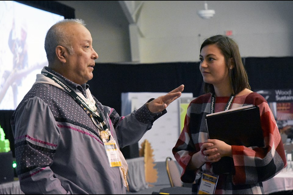Keynote speaker Dr. Dan Longboat, director of the Indigenous Environmental Institute, chats with a delegate at the Forests Ontario conference near Alliston, Feb. 8. Miriam King/Bradford Today