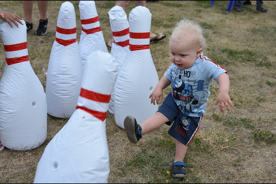 Two-year-old Sebastian enjoyed the inflatable bowling game, set up by town staff at the outdoor movie on July 12. Miriam King/BradfordToday