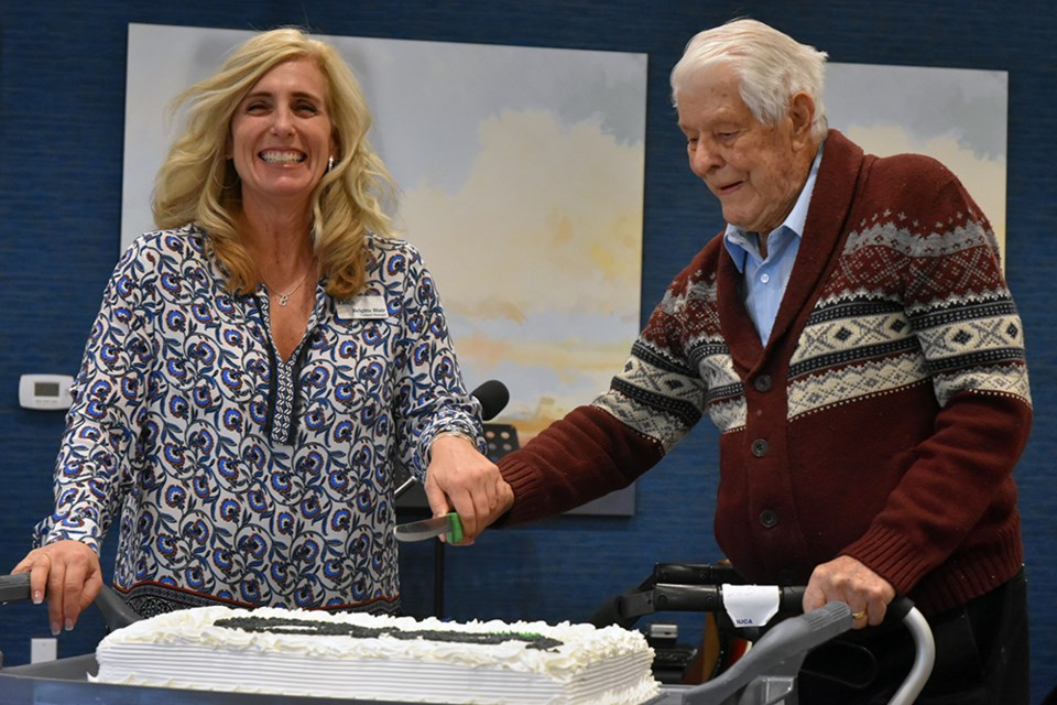 General Manager of The Elden Brigitte Blair and first resident Bob Sturgeon cut the cake, at The Elden's First Anniversary celebration. Miriam King/Bradford Today