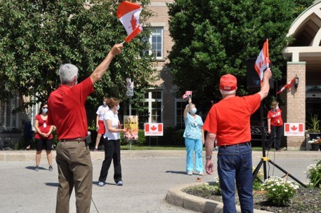 BWG Mayor Rob Keffer raised his flag while singing the national anthem for the staff and residents of the Bradford Valley Care Community. Jackie Kozak/BradfordToday