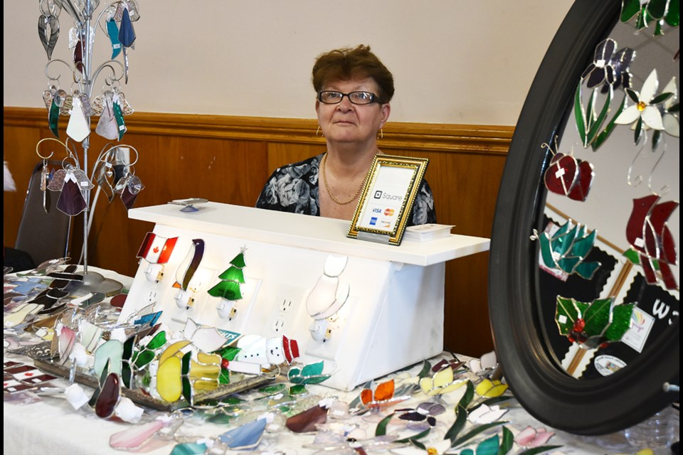 Orlene Fost, with colorful stained glass night lights. Miriam King/Bradford Today