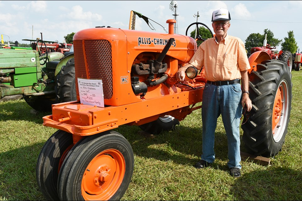 Charlie Wilcox, with the 1940 Allis-Chalmers his father bought new. Miriam King/BradfordToday