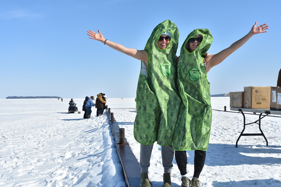 Dill pickles Michelle Druzina and Farren Giedraitis came all the way from Toronto to take the plunge in Lake Simcoe. Miriam King/Bradford Today