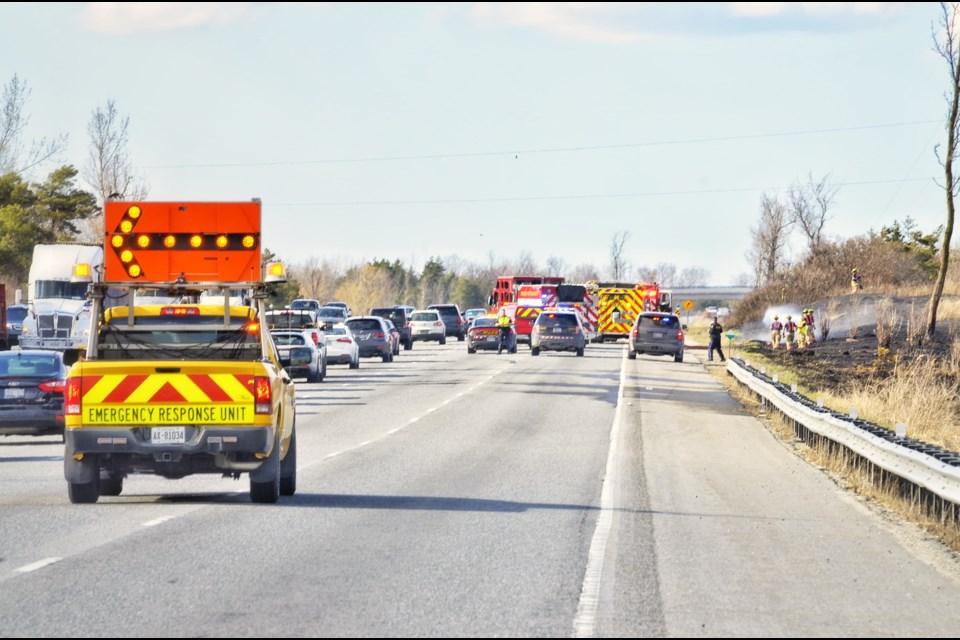 A grass fire burned along side Highway 400 on late Monday afternoon. Dave Kramer for BradfordToday