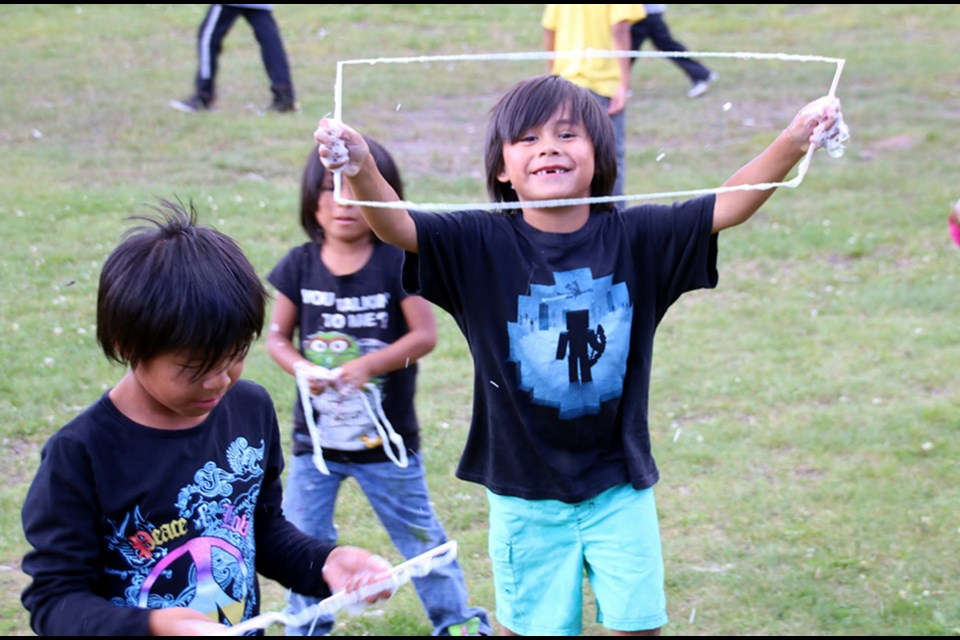 Kids of Mishkeegogamang First Nations enjoy summer camp, and making giant bubbles. SUBMITTED.