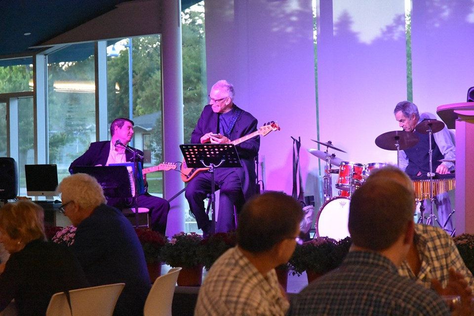 Mojo jazz trio entertained diners at the Lakeshore Library on Saturday, for the Rotary Club's inaugural Harvest Dinner. Miriam King/Bradford Today