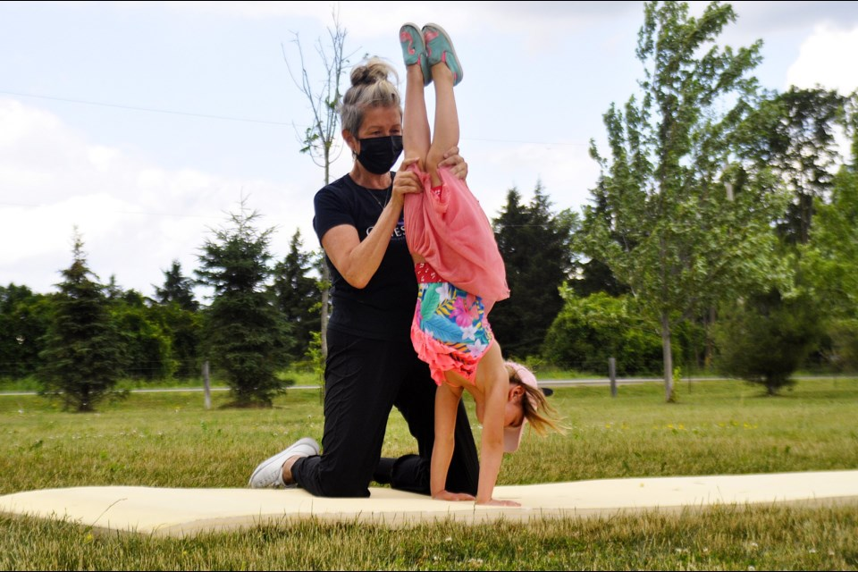 Genesis Gymnastics Owner Donna Katz held a free outdoor class at Henderson Park for children and will be launching her daycamps on July 5th.