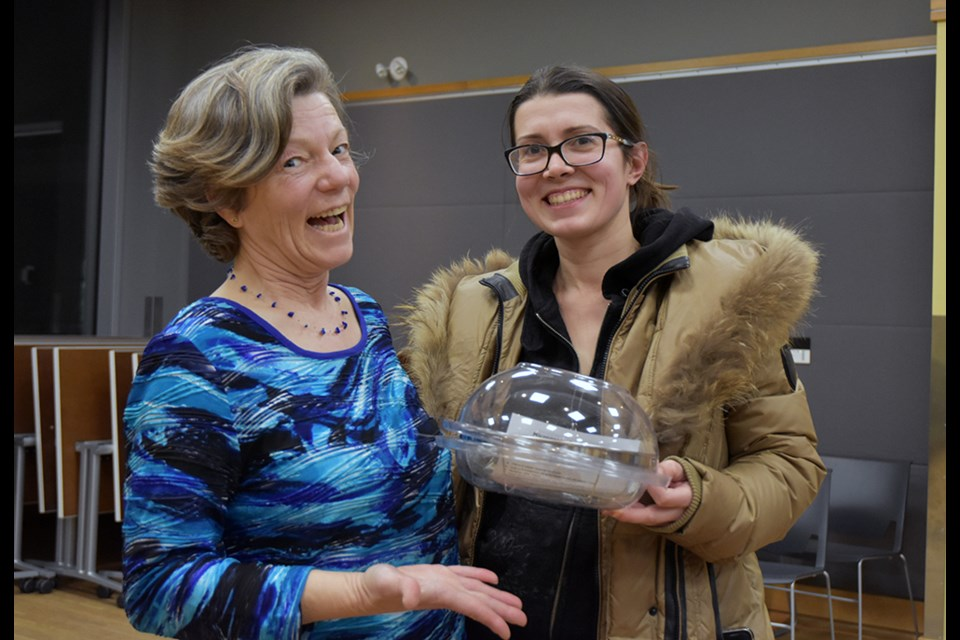 Cathy Nesbitt presents a Sprout Grower to draw winner Karina Sherman, at the Bradford Library. Miriam King/Bradford Today