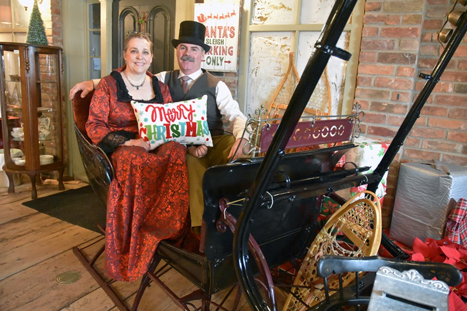 Bill and Diana Robinson, pose in the one horse open sleigh at the Cookstown Antique Market. Miriam King/Bradford Today