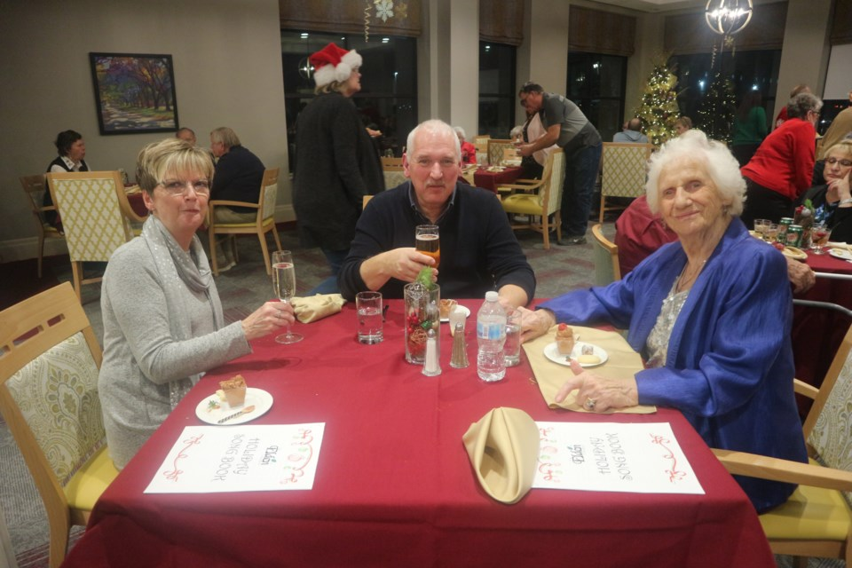 Lesley, Andy and Heidi enjoying their holiday party meal. Natasha Philpott/BradfordToday