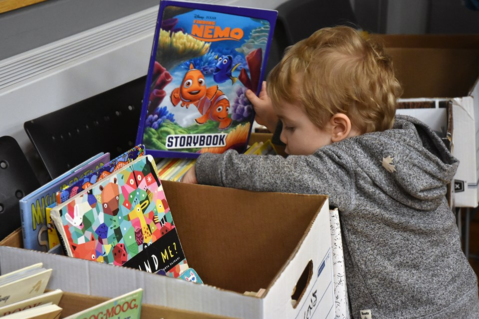 Kids can choose their own books, from boxes set at 'kid level,' at the Friends of the BWG Public Library Book Sale. Miriam King/Bradford Today